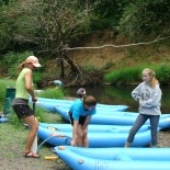 Preparing rafts for trip down Marys River, during Watershed Down summer camp