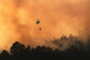 Helicopter over burning forest